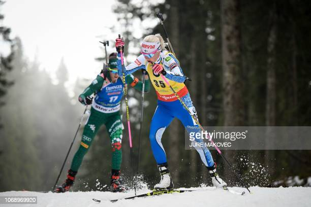 Finland's Kaisa Makarainen and Italy's Lisa Vittozzi compete during the IBU Biathlon World Cup Women's 15km Individual competition in Pokljuka on...