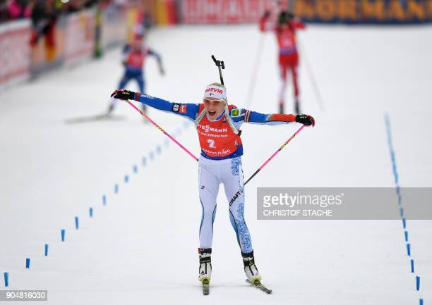 Finland's Kaisa Makarainen celebrates at the finishing line of the ladies 125 kilometer mass start competition at the Biathlon World Cup on January...