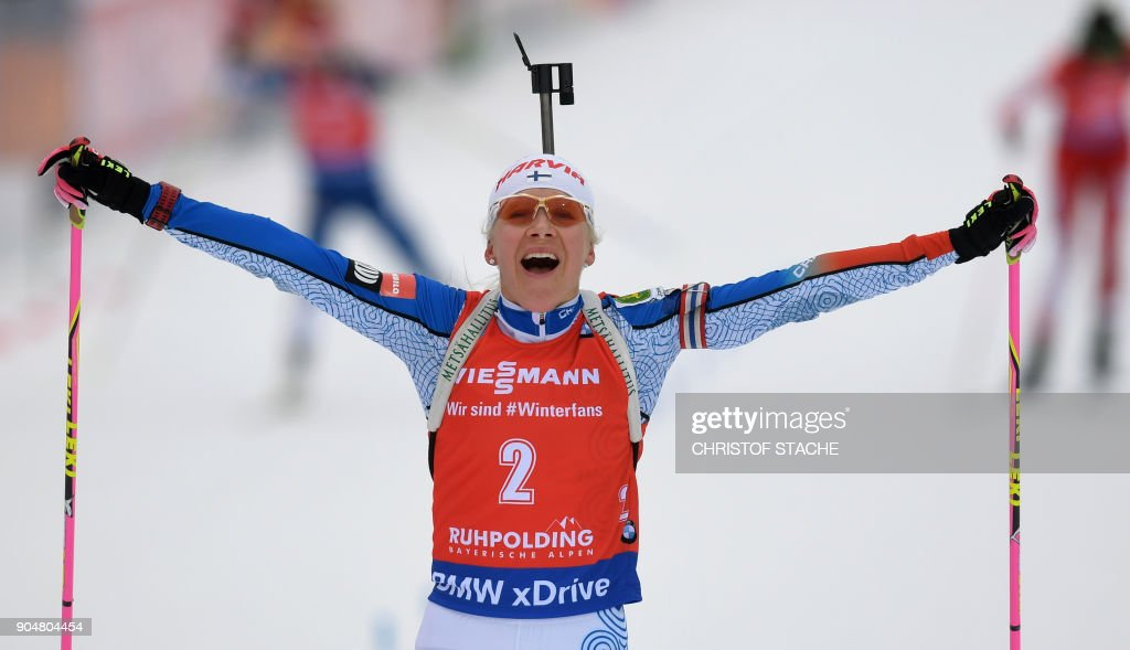 Finland's Kaisa Makarainen celebrates in the finish of the women 12,5 kilometer mass start competition of the Biathlon World Cup on January 14, 2018 in Ruhpolding, southern Germany. /