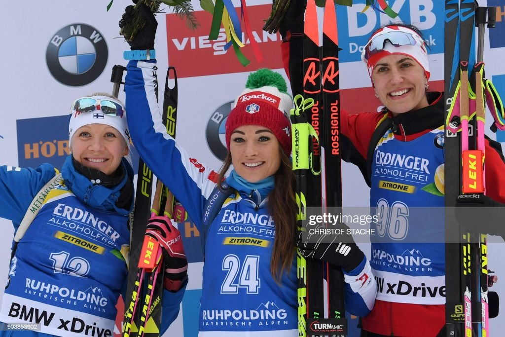Finland's Kaisa Makarainen, Italy's Dorothea Wierer and Canada's Rosanna Crawford celebrate on the podium after the women's 15 km individual event at the Biathlon World Cup on January 11, 2018 in Ruhpolding, southern Germany. Italy's Dorothea Wierer won the event ahead of Finland's Kaisa Makarainen (2nd) and Canada's Rosanna Crawford (3rd). /