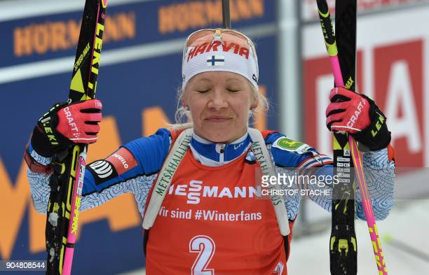 Finland's Kaisa Makarainen reacts in the finish of the women 125 kilometer mass start competition of the Biathlon World Cup on January 14 2018 in...