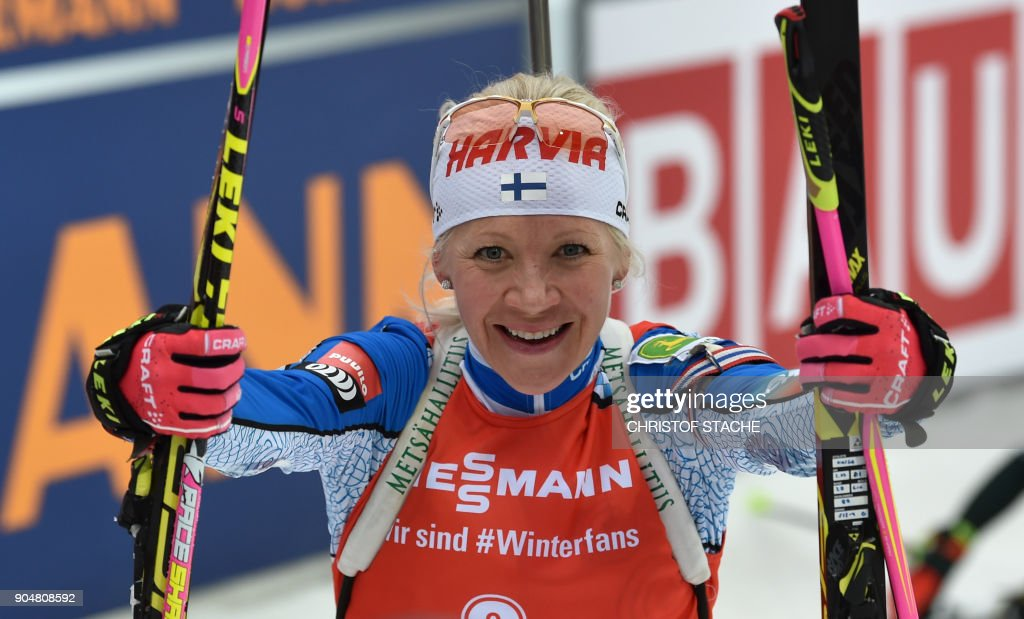 Finland's Kaisa Makarainen reacts in the finish of the women 12,5 kilometer mass start competition of the Biathlon World Cup on January 14, 2018 in Ruhpolding, southern Germany. /