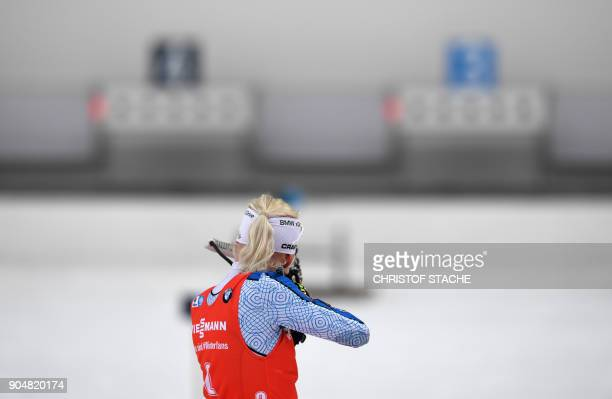 Finland's Kaisa Makarainen shoots during the women's 125 kilometer mass start competition at the Biathlon World Cup on January 14 2018 in Ruhpolding...
