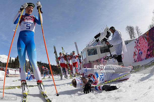 Finland's Kerttu Niskanen and France's Aurore Jean rest at the finish line as silver medalist Norway's Therese Johaug gold medalist Norway's Marit...