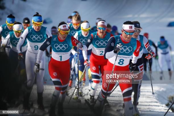 Finland's Kerttu Niskanen Norway's Heidi Weng Norway's Ingvild Flugstad Oestberg and Norway's Marit Bjoergen compete during the women's 30km cross...