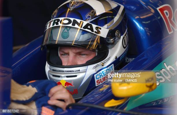 Finland's Kimi Raikkonen waits in his car prior to qualifying for the Belgian GP
