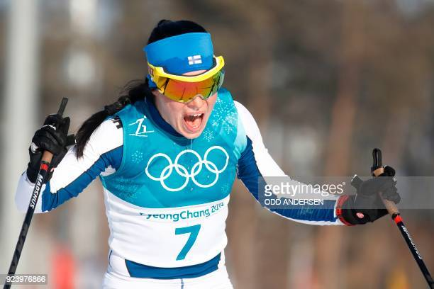 TOPSHOT Finland's Krista Parmakoski celebrates her silver medal win at the finish line for the women's 30km cross country mass start classic at the...