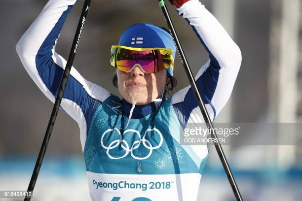 TOPSHOT Finland's Krista Parmakoski crosses the finish line to win bronze in the women's 10km freestyle crosscountry competition at the Alpensia...