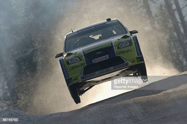 Finland's Marcus Gronholm and Timo Rautiainen drive their Ford Focus RS during day three of the Rally of Sweden February 5 2006 in Karlstad Sweden