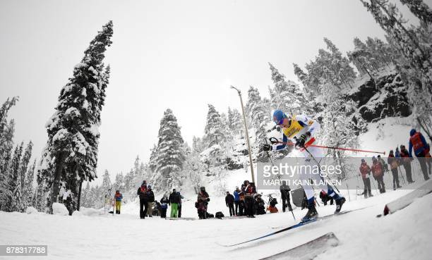Finland's Matti Heikkinen changes in action his stick as the first one broke during the men's qualifying of the Sprint Classic at the Ruka Nordic...