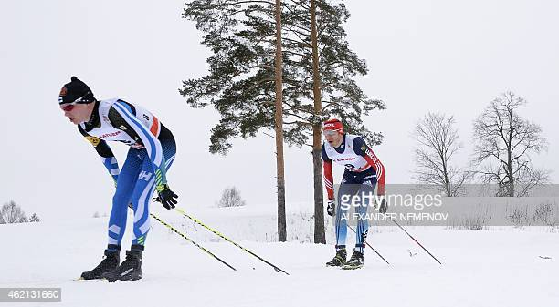 Finland's Matti Heikkinen competes to third place ahead of fourth placed Russia' Stanislav Volzhentsev during the men's skiathlon 15 km classic 15 km...