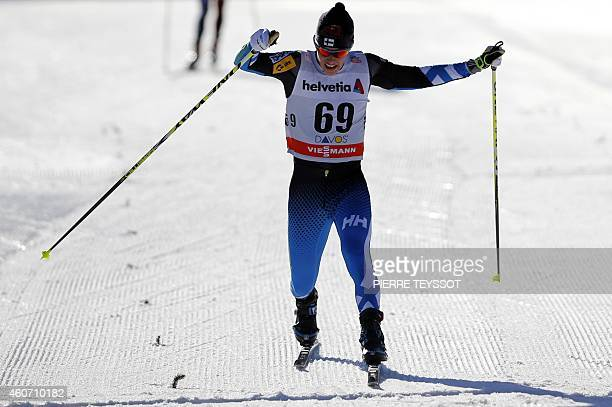 Finland's Matti Heikkinen crosses the finish line during the the Men's 15 km individual free event during the Nordic skiing FIS Crosscountry World...