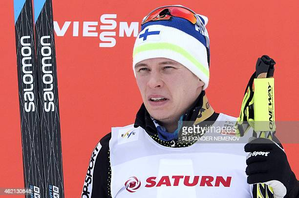 Finland's Matti Heikkinen poses on the podium after taking thirdplace in in the men's skiathlon 15 km classic 15 km free race of the FIS Crosscountry...