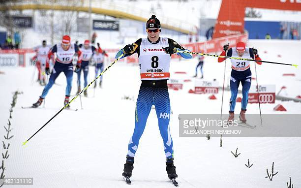 Finland's Matti Heikkinen reacts as he crosses the finish line in third place during the men's skiathlon 15 km classic 15 km free race of the FIS...