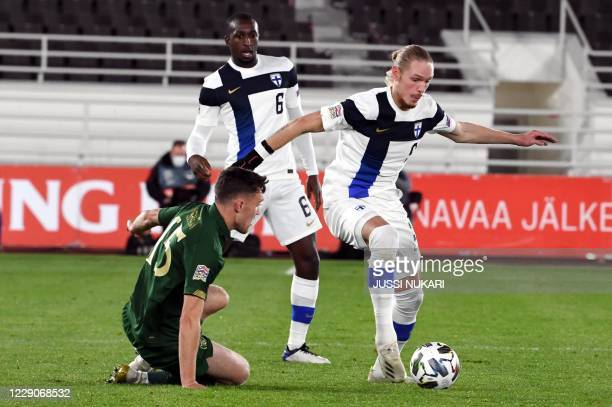 Finland's midfielder Fredrik Jensen and Ireland's defender Dara O'Shea O'Shea vie for the ball during the UEFA Nations League football match Finland...