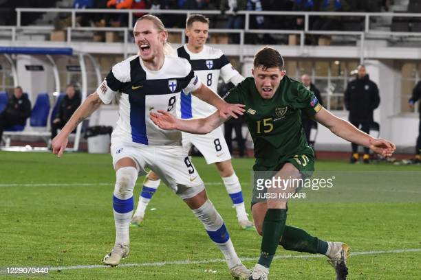 Finland's midfielder Fredrik Jensen celebrates scoring the opening goal next to Ireland's defender Dara O'Shea during the UEFA Nations League...