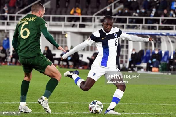Finland's midfielder Glen Kamara shoots next to Ireland's midfielder Conor Hourihane during the UEFA Nations League football match Finland v Ireland...