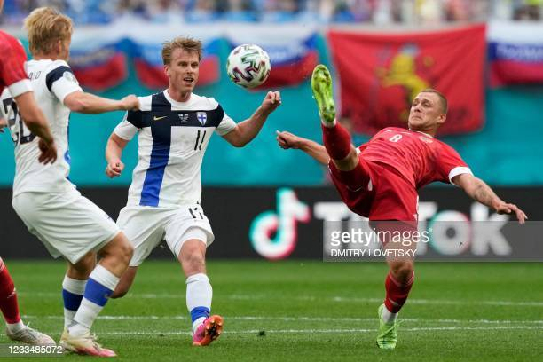 Finland's midfielder Rasmus Schuller and Russia's midfielder Dmitriy Barinov vie during the UEFA EURO 2020 Group B football match between Finland and...