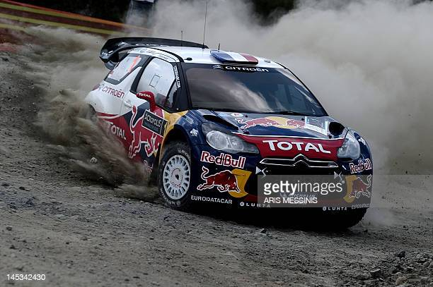 Finland's Mikko Hirvonen and codriver Jarmo Lehtinen drive their Citroen DS3 during the Agioi Theodoroi special stage of the WRC Acropolis rally in...