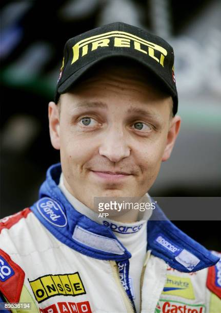 Finland's Mikko Hirvonen looks towards fans at the service park in Jyväskylä, Central Finland, on the second day of the WRC Rally Finland on July 31,...