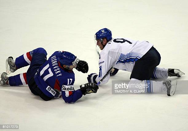 Finland's Mikko Koivu and Slovakia's Lubomir Visnovsky hit during the preliminary round of the 2008 IIHF World Hockey Championships at the Halifax...