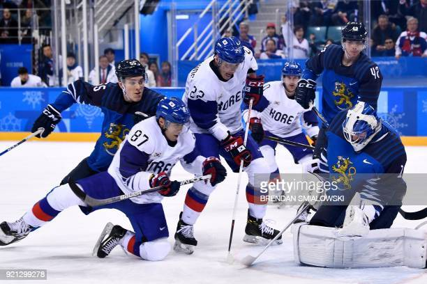 Finland's Mikko Koskinen defends in the men's playoffs qualifications ice hockey match between Finland and South Korea during the Pyeongchang 2018...