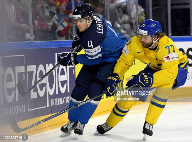 Finland's Mikko Lehtonen and Sweden's Victor Hedman vie for the puck during the Ice Hockey World Championship semifinal match between Finland and...