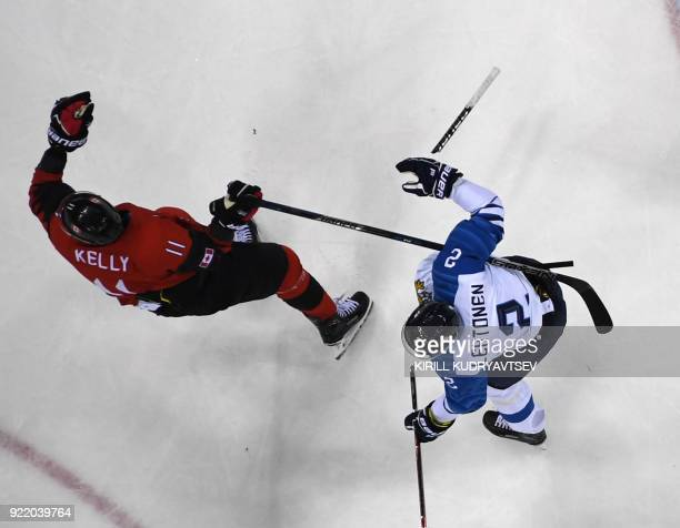 Finland's Mikko Lehtonen looks on as his stick breaks in the men's quarter-final ice hockey match between Finland and Canada during the Pyeongchang...