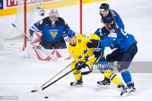Finland's Mikko Rantanen and Sweden's William Nylander vie for the puck during the Ice Hockey World Championship semi-final match between Finland and...