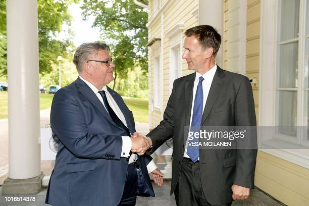 Finland's Minister for Foreign Affairs Timo Soini and his Britain's counterpart Jeremy Hunt shake hands during a joint press conference in Vantaa...