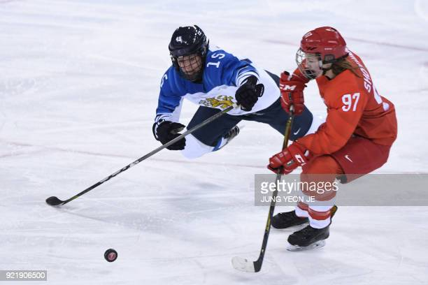 TOPSHOT Finland's Minnamari Tuominen and Russia's Anna Shokhina fight for the puck in the women's bronze medal ice hockey match between Finland and...