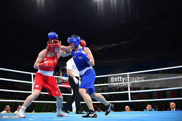 Finland's Mira Potkonen fights Ireland's Katie Taylor during the Women's Light Quarterfinal 1 match at the Rio 2016 Olympic Games at the Riocentro...