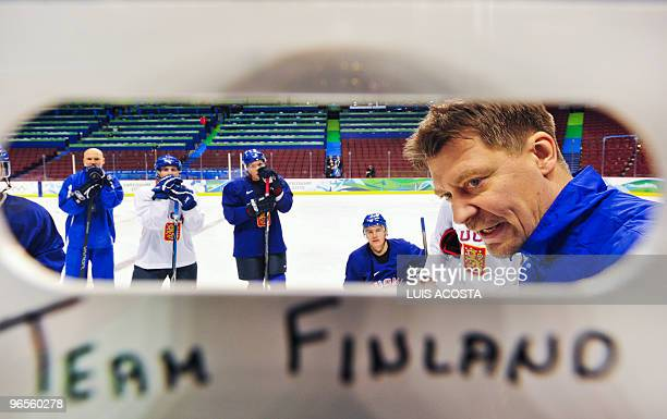 Finland's National hockey Head coach Jalonen Jukka gives instructions to his players during a training session at the Canada Hockey Place in...