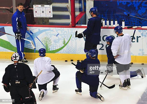 Finland's national hockey head coach Jalonen Jukka gives instructions to his players during a session training at the Canada Hockey Place, in...