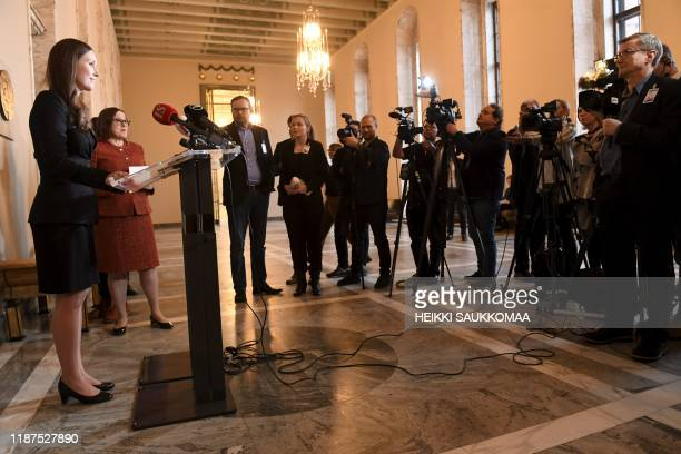 Finland's new prime minister Sanna Marin speaks to the media after she ws sworn in during a session of the Finnish Parliament in Helsinki Finland on...