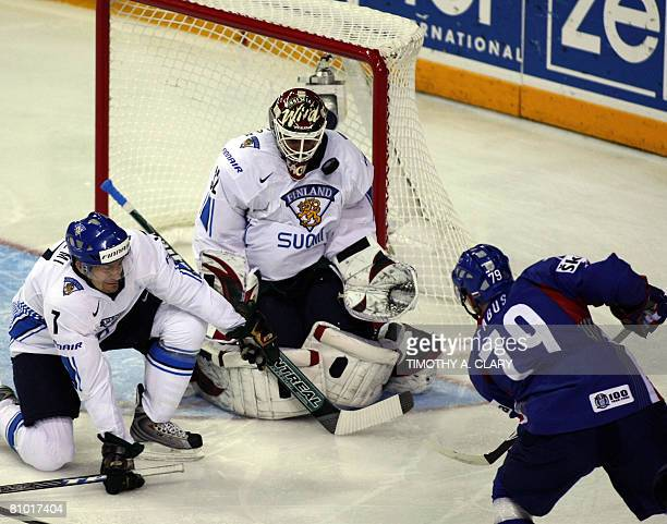 Finland's Niklas Backstrom stops a shot from Slovakia's Peter Fabus during the preliminary round of the 2008 IIHF World Hockey Championships at the...