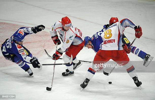 Finland's Niko Kapanen and Mikko Lehtonen fight for the puck with Russia's Alexander Suglobov and Alexey Mikhnov during their match of the Euro...