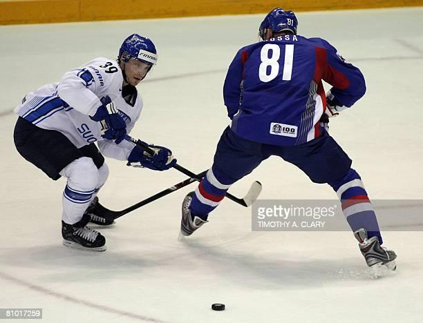 Finland's Niko Kapanen and Slovakia's Marcel Hossa strike during the preliminary round of the 2008 IIHF World Hockey Championships at the Halifax...