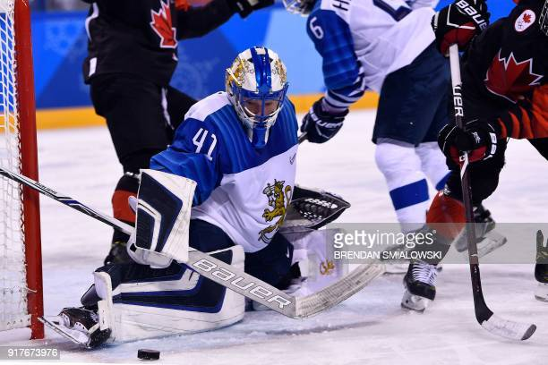 Finland's Noora Raty defends the goal during the final period of the women's preliminary round ice hockey match between Canada and Finland during the...