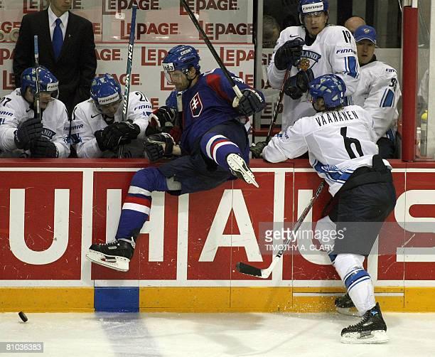 Finland's Ossi Vaananen checks Slovakia's Radovan Somik during the preliminary round of the 2008 IIHF World Hockey Championships at the Halifax Metro...