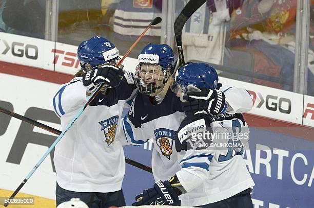 Finland's Patrik Laine Jesse Puljujärvi and Aleksi Saarela celebrate the 13 goal by Saarela during the 2016 IIHF World Junior Ice Hockey Championship...