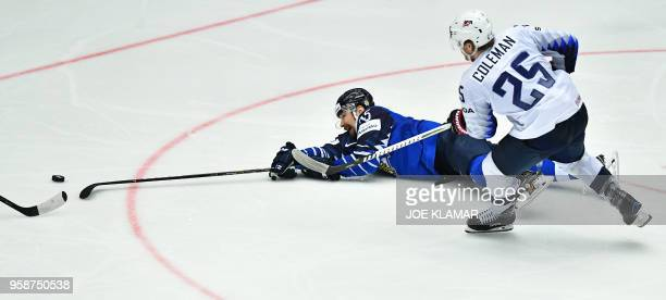 Finland's Pekka Jormakka challenges for the puck with Blake Coleman of the United States during the group B match Finland vs the United States of the...