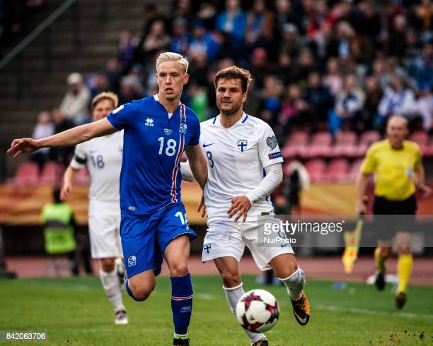 Finland's Perparim Hetemaj and Iceland's Hordur Magnússon fight for the ball during the FIFA World Cup 2018 Group I football qualification match...