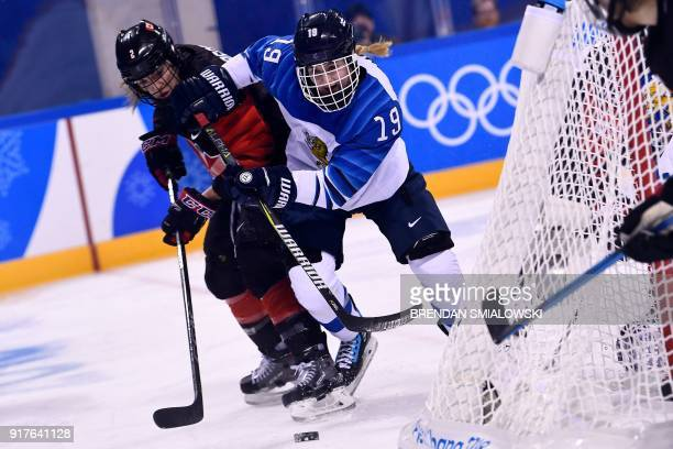 Finland's Petra Nieminen chases the puck during the first period of the women's preliminary round ice hockey match between Canada and Finland during...