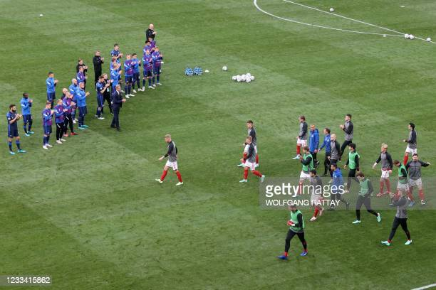 Finland's players applaud Denmark's players entering the pitch to warm up as the UEFA EURO 2020 Group B football match between Denmark and Finland...