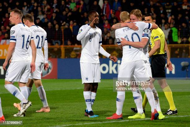 Finland's players celebrate a goal during the Euro 2020 football qualification match between Armenia and Finland in Yerevan on March 26 2019