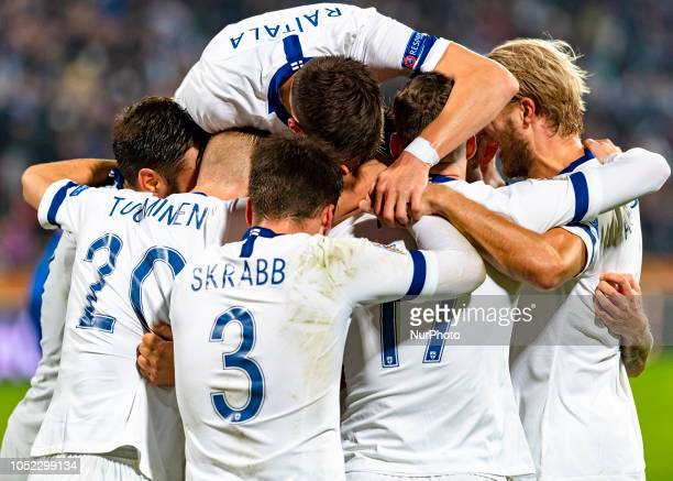 Finland's players celebrate a scoring during the UEFA Nations League group stage football match Finland v Grece in Tampere Finland on October 15 2018