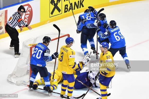 Finland's players celebrate after scoring the 4-4 during the IIHF Men's Ice Hockey World Championships quarter-final match between Finland and Sweden...