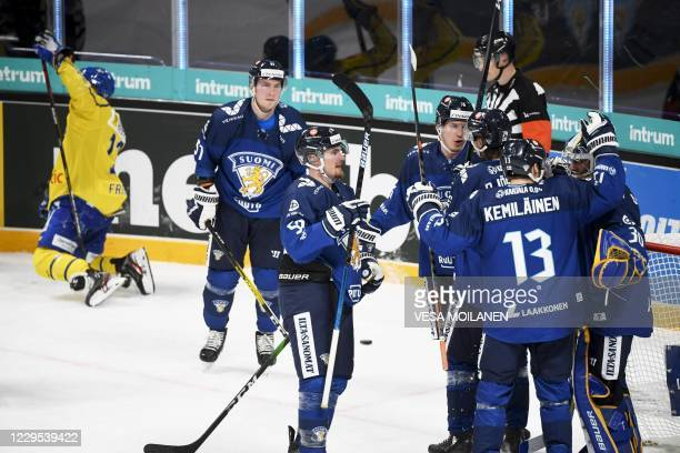 Finland's players celebrate after winning the Ice Hockey Karjala Tournament match between Finland and Sweden as part of the Euro Hockey Tour season...