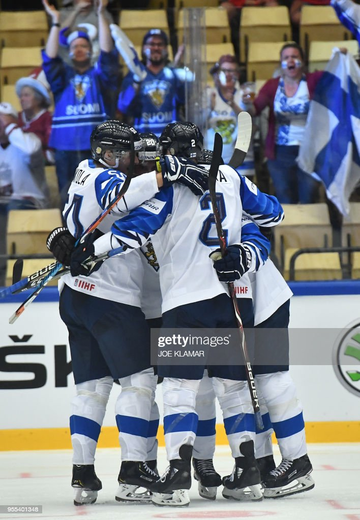 Finland's players celebrate their goal during the group B match Latvia vs Finland of the 2018 IIHF Ice Hockey World Championship at the Jyske Bank Boxen in Herning, Denmark, on May 6, 2018.